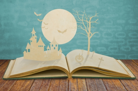 workbook: Paper cut of halloween on old book Stock Photo