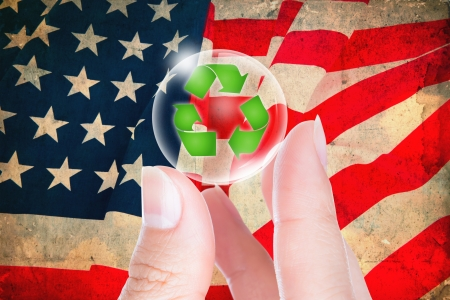 Business hand hold recycling symbol in bubble on vintage flag USA photo