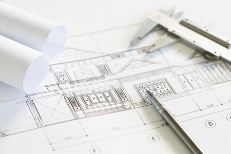 Construction plans and drawing tools on blueprints Stock Photo