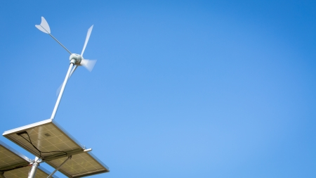 Wind turbine over blue sky photo