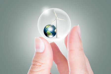 Eco concept : Business hand hold earth and turbine in bubble  photo
