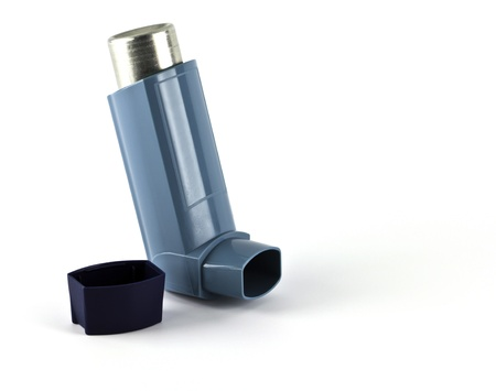 Asthma inhaler isolated on a white background. photo