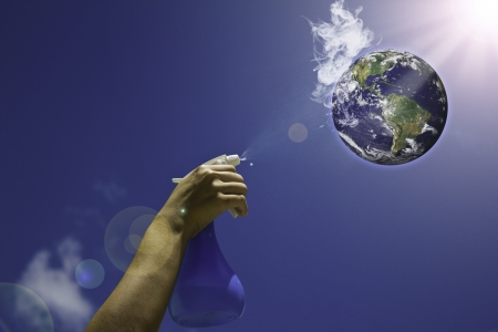Hand spayed with water to earth because Global warming . (Global warming concept) photo