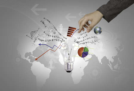 world energy: Light bulb in hand with graph out