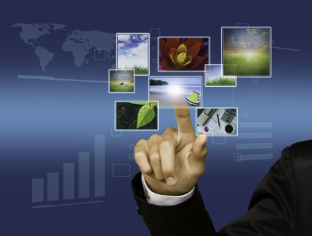 Business Hand touches the flow of images