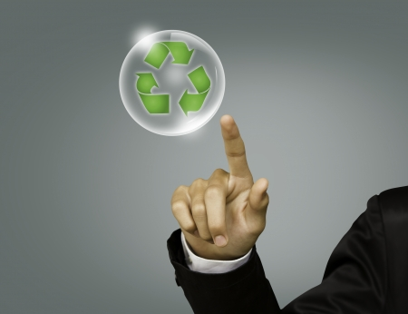 Eco concept : Business hand point recycling symbol in bubble photo
