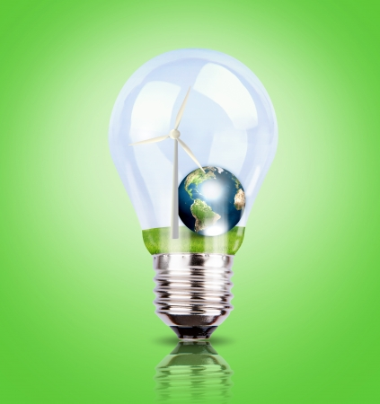 Light bulb with wind turbine and earth inside  (Elements of this image furnished by NASA) photo