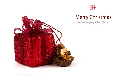 Chocolate cupcake and gifts in boxes on a white background photo