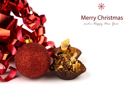 Christmas cupcakes with christmas decoration isolated on white background photo
