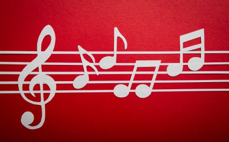 Paper  cut of music note on staves with copy space for text or design photo