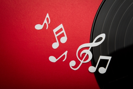 Paper  cut of music note on Black vinyl record lp album disc with copy space for text or design photo