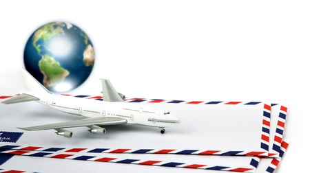 airmail: Airmail envelope with model airplane and earth