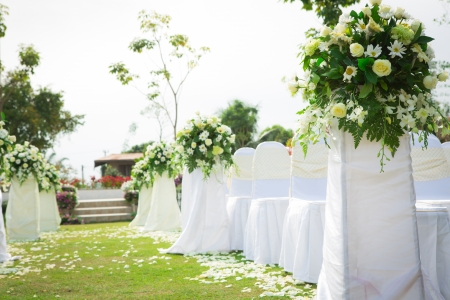 Wedding ceremony in a beautiful garden photo