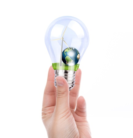 viewfinderchallenge3: Hand holding light bulb with wind turbine and earth inside (Elements of this image furnished by NASA)