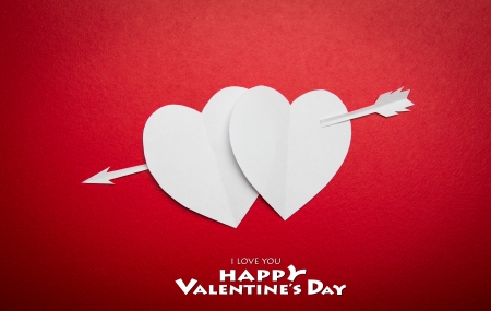 Two paper hearts pierced with an arrow symbol for Valentines day  with copy space for text or design Stock Photo - 17483578