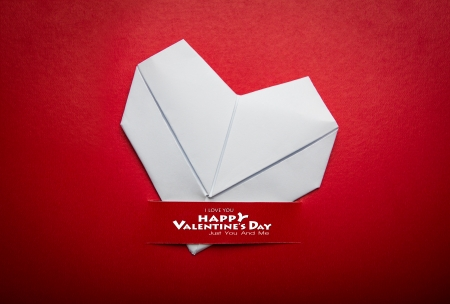 Origami  paper  heart shape symbol for Valentines day  with copy space for text or design photo