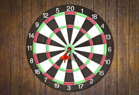 Dartboard on wood wall (Darts Hit Target) photo