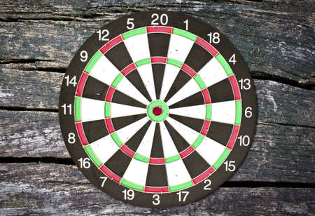 Dartboard on wood wall (Darts Hit Target) photo