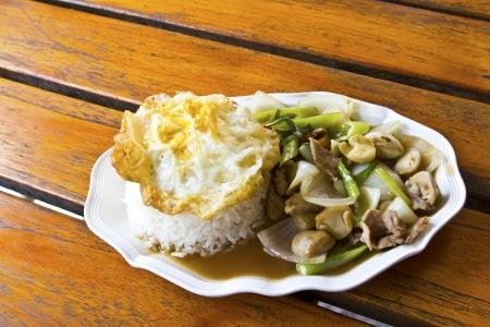 Asian cuisine, a fried egg on rice. Stock Photo - 17485143