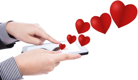 Business man using a touch screen device with heart photo