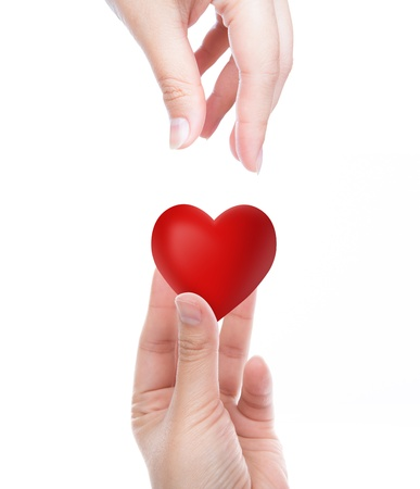 goodness: Red heart in woman hand Stock Photo