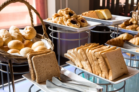 breakfast hotel: Assortment of fresh pastry on table in buffet