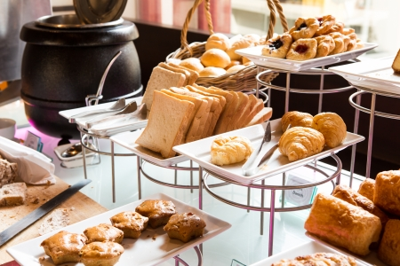 dessert buffet: Assortment of fresh pastry on table in buffet