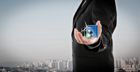 Business man hold Alternative Energy (solar cell, earth, wind turbine ) Elements of this image furnished Stock Photo - 17988779