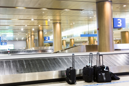 Suitcases at airport interior at baggage claim