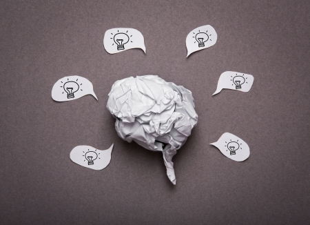 Medical background, Crumpled paper brain shape with light bulb photo