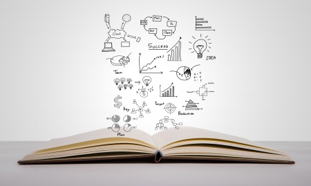 erp: Magic book with business concept and graph Stock Photo
