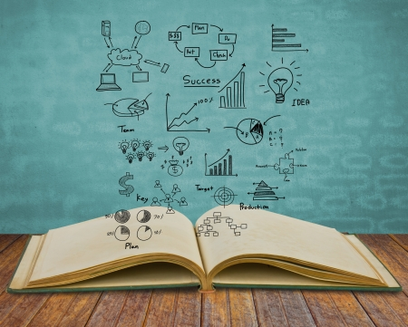 infomation: Magic book with business concept and graph Stock Photo