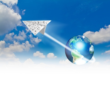 Graph paper planes in blue sky with earth  photo