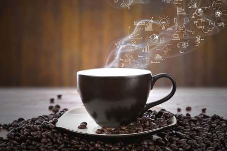 Coffee cup and beans with business graph on smoke photo