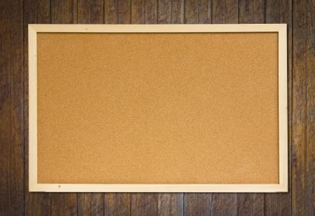 noteboard: cork bulletin board on wood wall