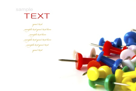 noteboard: Group of colorful push pins on white background. Stock Photo