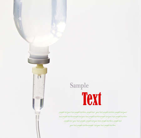 infusion: Infusion bottle with IV solution on white background with copy space.