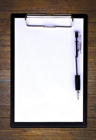 Clip board and papers isolated photo