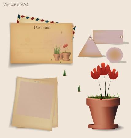 Carte postale de cru et l'enveloppe avec l'usine de fleur rouge dans un pot en argile.