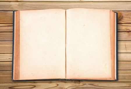 Open old vintage book on wooden background photo