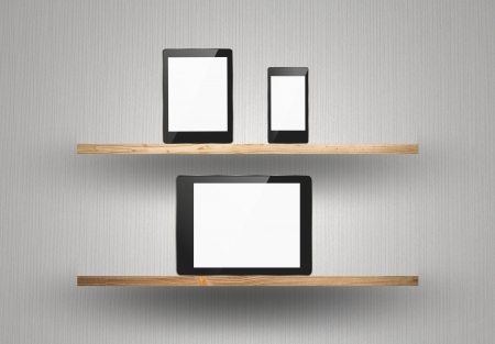 Touch screen device on wood shelf photo