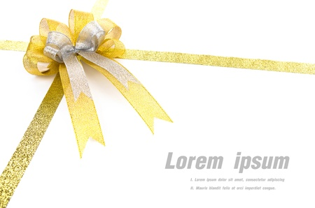 bow knot: Shiny gold ribbon on white background with copy space.