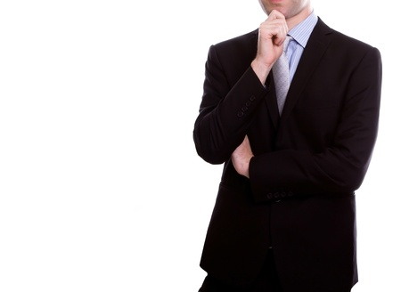 Portrait of young business man against white background photo