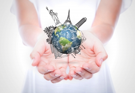 top of the world: Woman hands hold travel around the world (Japan,France,Italy,New York,India,egypt) over body isolated on background.  (Elements of this image furnished by NASA) Stock Photo