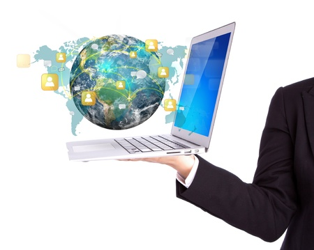 Business person holding Laptop with social network on earth photo