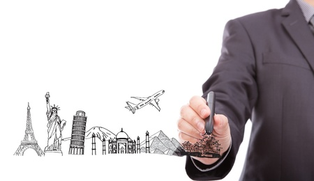 Businessman drawing  World travel (Japan,France,Italy,New York,India,egypt) photo