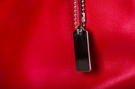Red leather texture with metal tag Stock Photo - 22148447