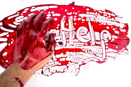 Halloween concept : bleeding hand on the white background photo