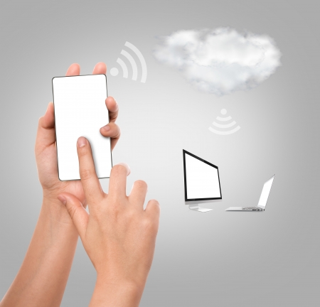 Hhand holding mobile phone with cloud computing photo