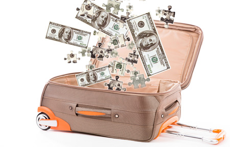 Money in suitcase isolated on white photo